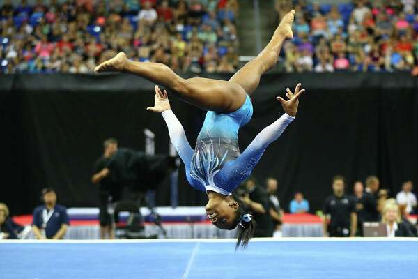 ST. LOUIS, MO - JUNE 26: Simone Biles competes in the floor exercise during day two of the 2016 P&G Gymnastics Championships at Chafitz Arena on June 26, 2016 in St. Louis, Missouri.