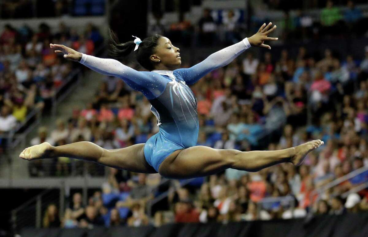 Simone Biles competes in the floor exercise during the U.S. women's gymnastics championships Sunday, June 26, 2016, in St. Louis. (AP Photo/Jeff Roberson)