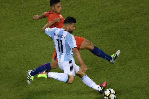 Chile's Gonzalo Jara, top, gives Argentina's Sergio Aguero little room to operate.