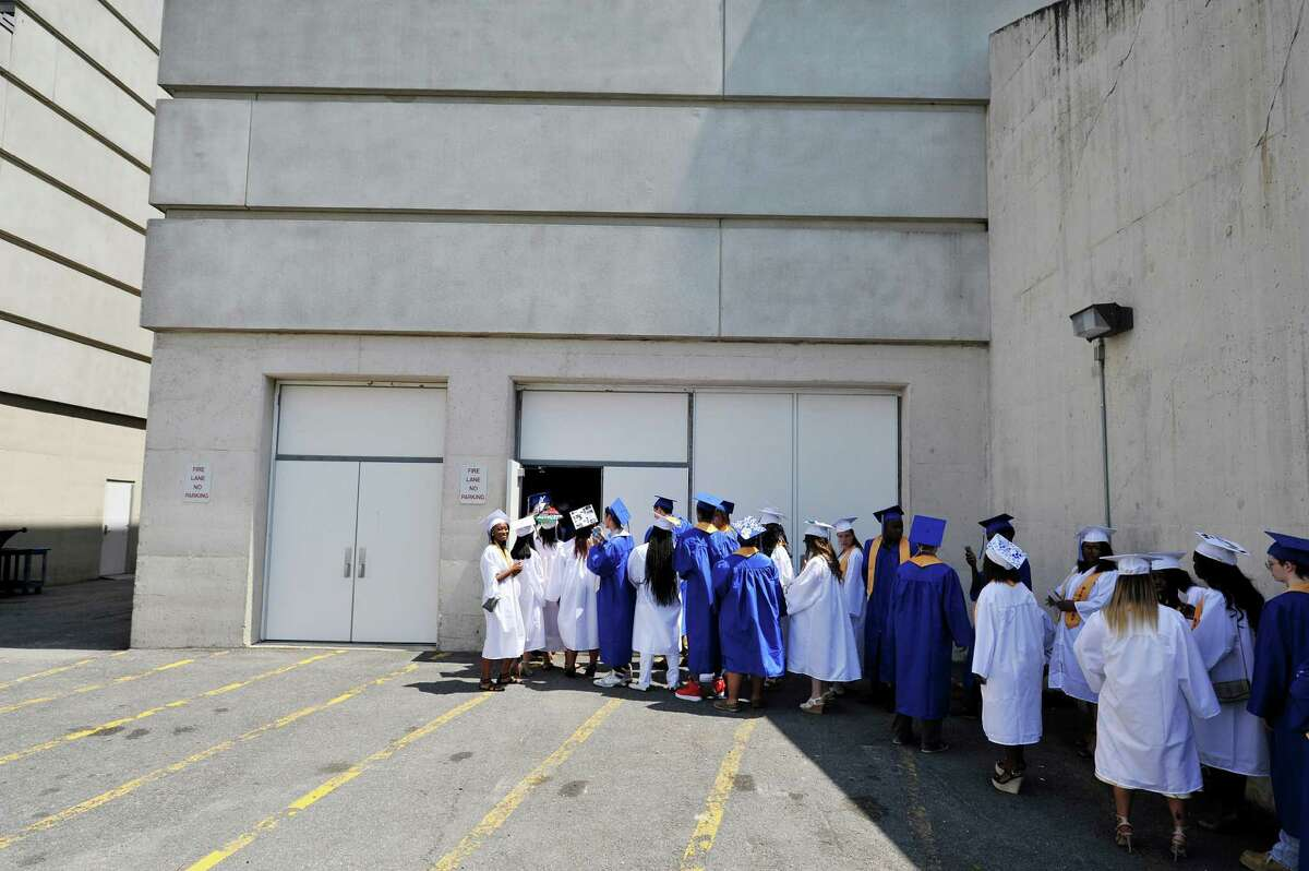 Albany High School graduates make their way into the SEFCU Arena for the start of their graduation ceremony on Sunday, June 26, 2016, in Albany, N.Y. This year the school graduated 480 students. (Paul Buckowski / Times Union)