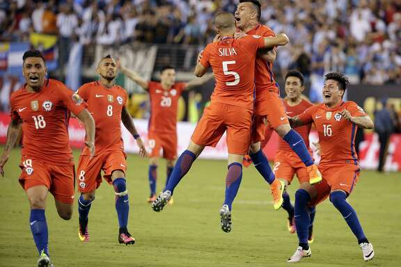 Teammates celebrate with Chile's Francisco Silva (5) after he scored the final goal against Argentina during penalty kicks in the Copa America Centenario championship soccer match, Sunday, June 26, 2016, in East Rutherford, N.J. (AP Photo/Julie Jacobson)