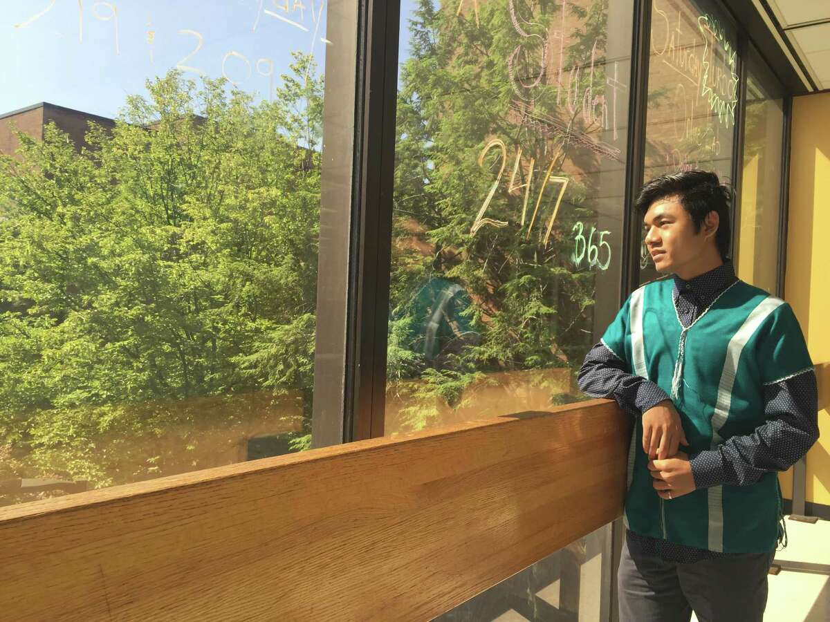 Ar Kee, an Albany High School graduate, is the first in his family to graduate high school. His family fled the Mae La refugee camp in Thailand for the U.S. in 2008 when he was 9 years old. (Bethany Bump/Times Union)