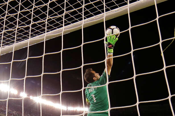 Chile goalkeeper Claudio Bravo leaps to make a save during extra time of the Copa America Centenario championship soccer match, Sunday against Argentina, June 26, 2016, in East Rutherford, N.J. (AP Photo/Julie Jacobson) ORG XMIT: COPA172