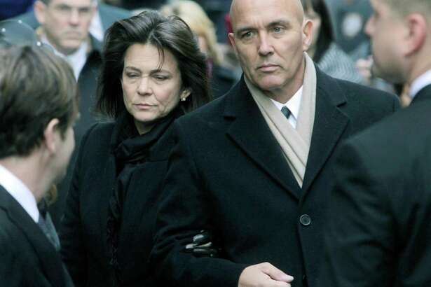 Madonna Badger and Michael Borcina attend the funeral of Badger's three children in New York in January 2012. Badger's former husband, Matthew Badger, has filed a wrongful death lawsuit against the city of Stamford and some of its officials, but Borcina has not turned over key documents and no one has been able to reach him.