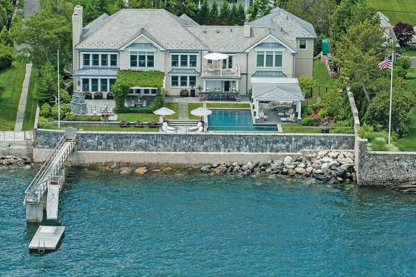 12 Indian Dr, Old Greenwich, CT 06870   5 beds 8 baths 7,270 sqft  Features:  poolside terrace, pergola-covered dining  area, stone fireplace and summer kitchen with gas and charcoal grills, boat dock    View full listing on Zillow