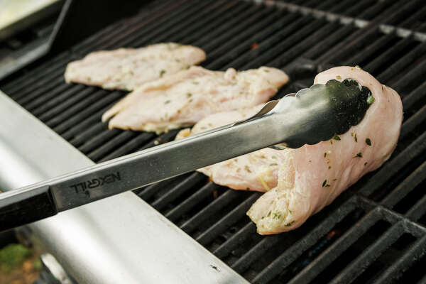 Grilling chicken breasts, in New York, May 10, 2016. Food — specifically food eaten outdoors — is a huge part of the upcoming Fourth of July holiday. Whether you're enjoying a barbecue in the great outdoors, traveling to see family or friends, or spending time at home, the U.S. Department of Agriculture's Food Safety and Inspection Service urges everyone to take extra food safety precautions when planning their menu. (Sasha Maslov/The New York Times)