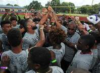 Earl Thomas, left center, huddles with campers during the West Orange-Stark graduate's fifth annual football camp at West Orange-Stark High School on Friday. Day 2 of the camp will take place today at the school.
