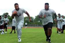 Earl Thomas encourages campers by running drills with them during the famed football player's camp at West Orange-Stark on Friday. Photo taken Friday, June 24, 2016 Guiseppe Barranco/The Enterprise