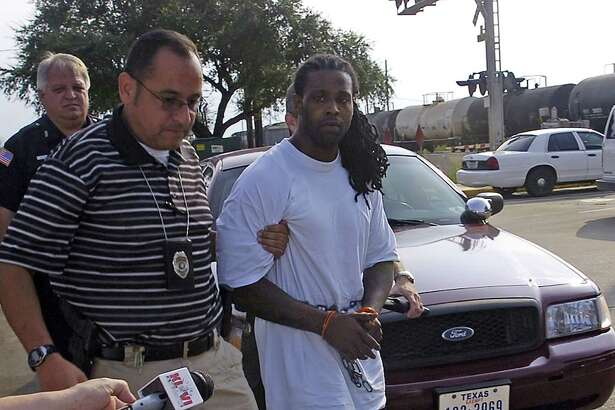 Joseph Kenneth Colone Jr., right, wanted in connection with the murder of a Beaumont mother and her daughter, was arrested in Houston and brought into Beaumont this Wednesday morning.    Dave Ryan/The Enterprise