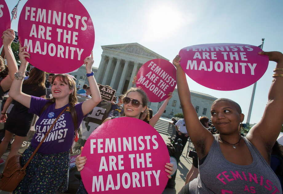 Activists demonstrate in front of the Supreme Court in Washington, June 27, 2016, as the justices close out the term with decisions on abortion, guns, and public corruption expected. (AP Photo/J. Scott Applewhite) Photo: J. Scott Applewhite, Associated Press / AP