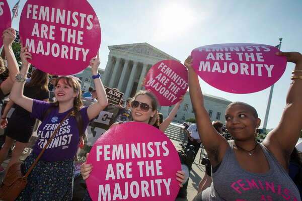 Activists demonstrate in front of the Supreme Court in Washington, June 27, 2016, as the justices close out the term with decisions on abortion, guns, and public corruption expected. (AP Photo/J. Scott Applewhite)