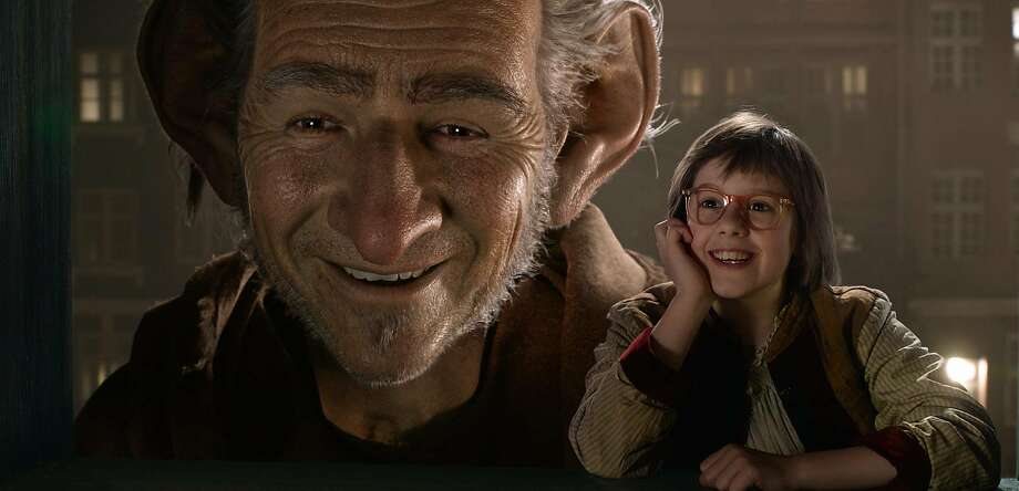 """Ruby Barnhill and the Big Friendly Giant from Giant Country, voiced by Mark Rylance, in """"The BFG."""" Photo: Null, Associated Press"""