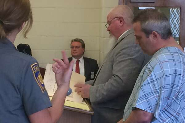 Kevin Mohan, right, was arraigned in Bantam Monday afternoon after prosecturos said he was involved in a standoff with police on Sunday that left a New Milford officer with a minor gunshot wound. His attorney, Lawrence Peck, accompanied him in court.