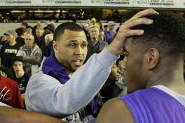 Former NBA basketball player and Garfield High School alumnus Brandon Roy, left, greets Garfield's Jaylen Nowell, center, after Nowell scored 23 points to lead Garfield to beat Rainier Beach 66-51 to win the boys 3A high school basketball championship, Saturday, March 7, 2015, in Tacoma, Wash. (AP Photo/Ted S. Warren)