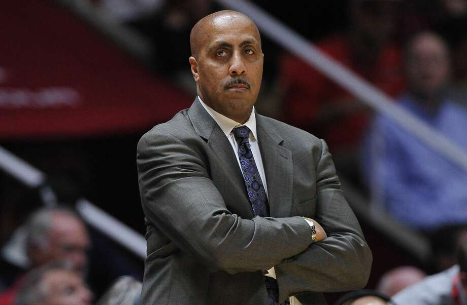 Washington men's basketball head coach Lorenzo Romar has been 'sadly transparent' in his latest efforts to attract blue-chip talent to UW, according to columnist Jim Moore. Photo: Gene Sweeney Jr./Getty Images
