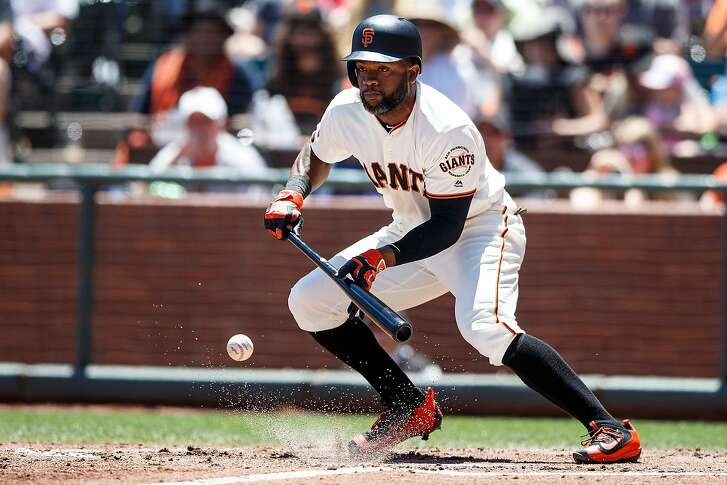 SAN FRANCISCO, CA - JUNE 26: Denard Span #2 of the San Francisco Giants bunts for a single against the Philadelphia Phillies during the third inning at AT&T Park on June 26, 2016 in San Francisco, California. The San Francisco Giants defeated the Philadelphia Phillies 8-7. (Photo by Jason O. Watson/Getty Images)