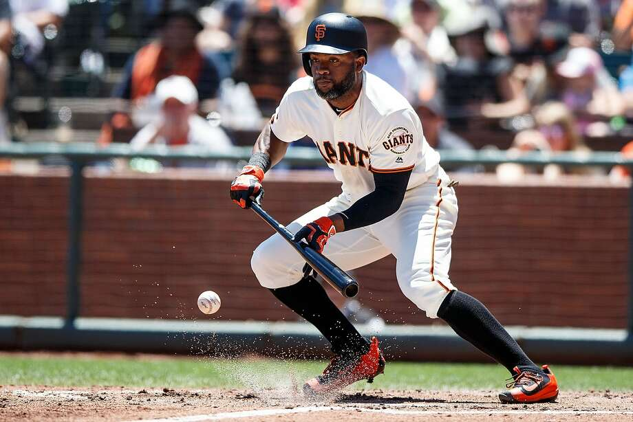 Denard Span bunts for his only hit in Sunday's 8-7 victory. Photo: Jason O. Watson, Getty Images