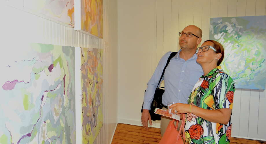 """Artist Katy Ferrarone at the opening of her """"Mind Maps"""" art show at Southport Galleries Friday evening. Photo: Mike Lauterborn / For Hearst Connecticut Media / Fairfield Citizen"""