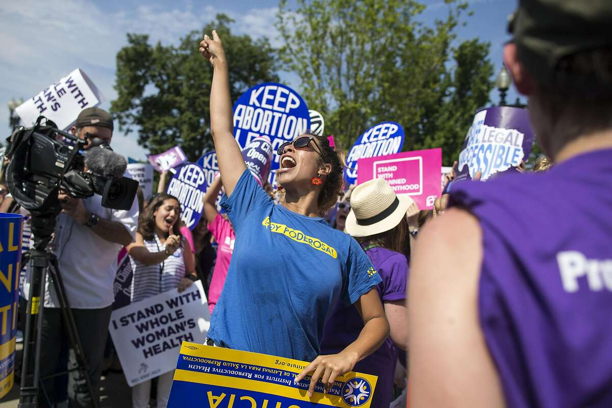 Pro-abortion rights demonstrators react to news of the U.S. Supreme Court's decision on abortion, outside the court in Washington, June 27, 2016. The court on Monday struck down parts of a restrictive Texas law that could have reduced the number of abortion clinics in the state to about 10 from what was once a high of roughly 40. (Al Drago/The New York Times)