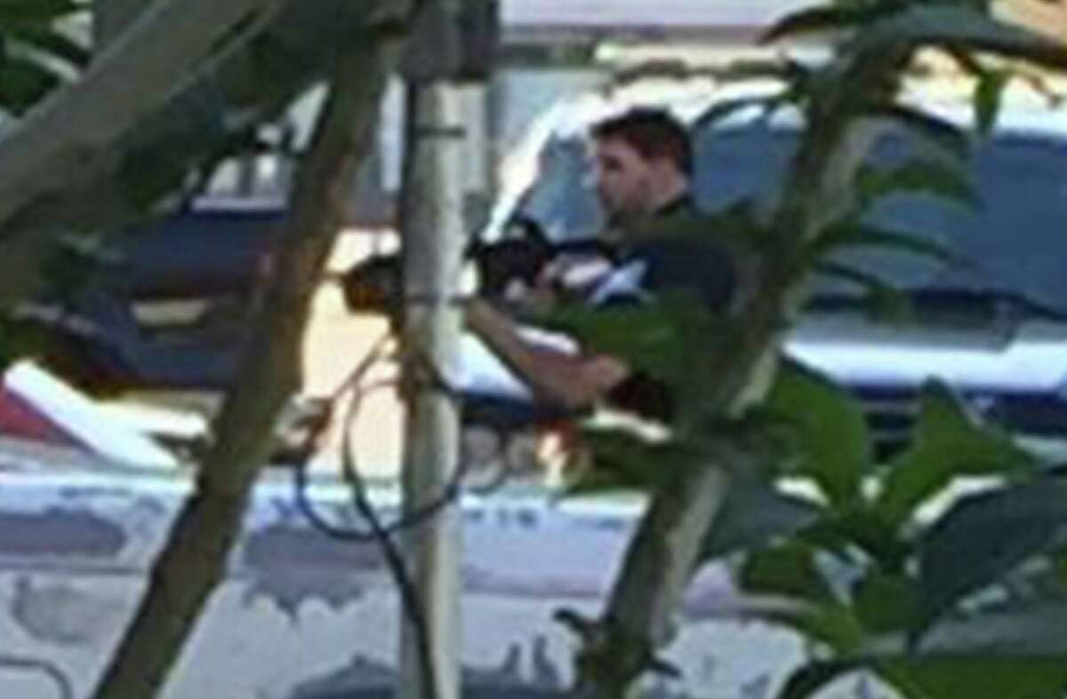 Chase Welch, the Beaumont Police officer involved in two fatal shootings in 2016, has resigned from the department, effective Friday, a department spokesperson said. Pictured, Enlargement of the previous photo showing Beaumont Police officer Chase Welch carrying a rifle toward Herby Balance's home during a March incident where Welch shot and killed Ballance. The photo was taken by a Ballance family member from behind a bush. Photo provided by Richard Waits