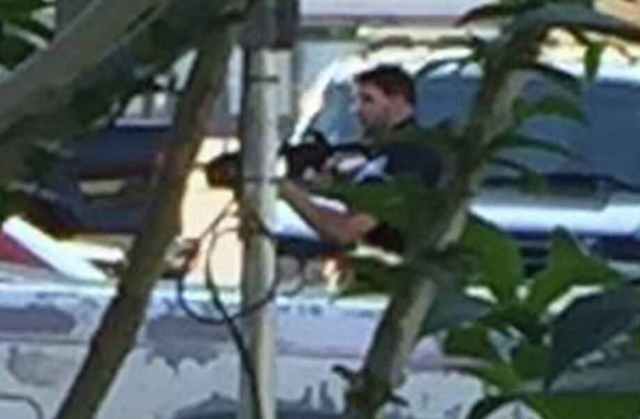 Chase Welch, the Beaumont Police officer involved in two fatal shootings in 2016, has resigned from the department, effective Friday, a department spokesperson said. Pictured,Enlargement of the previous photo showing Beaumont Police officer Chase Welch carrying a rifle toward Herby Balance's home during a March incident where Welch shot and killed Ballance. The photo was taken by a Ballance family member from behind a bush. Photo provided by Richard Waits