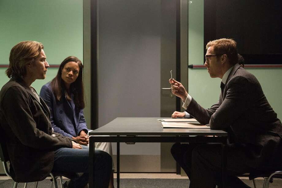 "Ewan McGregor (left), Naomie Harris and Damian Lewis in ""Our Kind of Traitor."" Photo: Japp Buitendijk/StudioCanal, TNS"