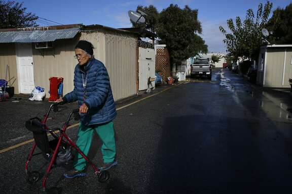 Claire Maupin, 89, makes her way to the mailboxes at Buena Vista Mobile Home Park Nov. 24, 2015 in Palo Alto, Calif. Maupin has lived in the park for a few years and doesn't have a plan for an alternative housing situation.
