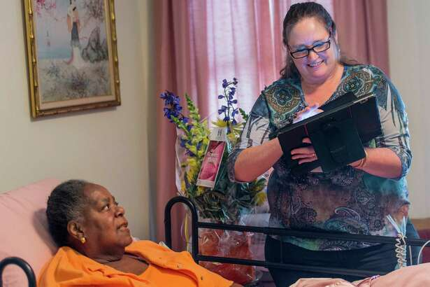 Virginia Oliver gets a visit at her home in Bridgeport, CT from Collette Sengupta of the Visiting Nurse Services of Connecticut on Friday, June 24, 2016. With this meeting the Visiting Nurse Services of Connecticut reached the 10 Million patient care visits mark.