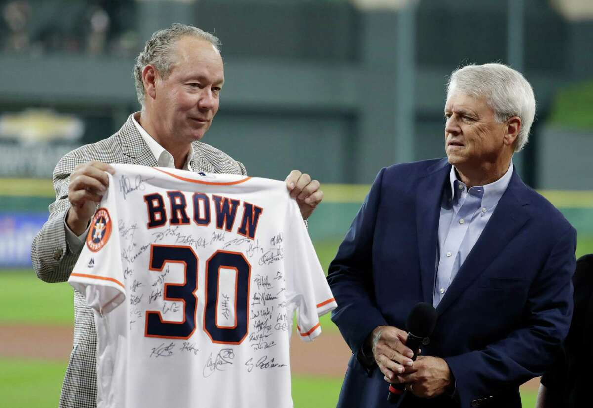 Houston Astros broadcaster Bill Brown, right, is recognized for 30 years of service by team owner Jim Crane before a baseball game Sunday, June 19, 2016, in Houston.