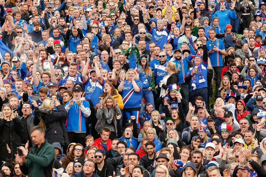 Icelandic soccer fans watch the Euro 2016 round of 16 match between Iceland and England on a large screen in Reykjavik, Iceland, Monday June 27, 2016.  Iceland pulled off the shock of the European Championship by beating England 2-1 in the round of 16 on Monday, continuing the improbable run of the smallest nation at the tournament. (AP Photo/Brynjar Gunnarsson) Photo: Brynjar Gunnarsson, Associated Press