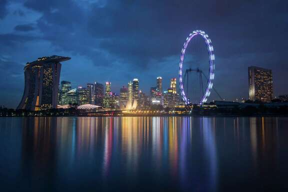 The Singapore Flyer, the largest Ferris wheel outside the United States, is seen downtown. MUST CREDIT: Washington Post photo by Jabin Botsford.