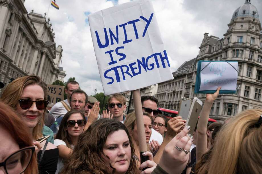 Anti-Brexit protesters demonstrate in Parliament Square, in Westminster, central London, June 25, 2016. Britain's startling decision to pull out of the European Union set off a cascade of aftershocks on Friday, costing Prime Minister David Cameron his job, plunging the financial markets into turmoil and leaving the country's future in doubt. (Adam Ferguson/The New York Times) Photo: ADAM FERGUSON, STR / NYTNS