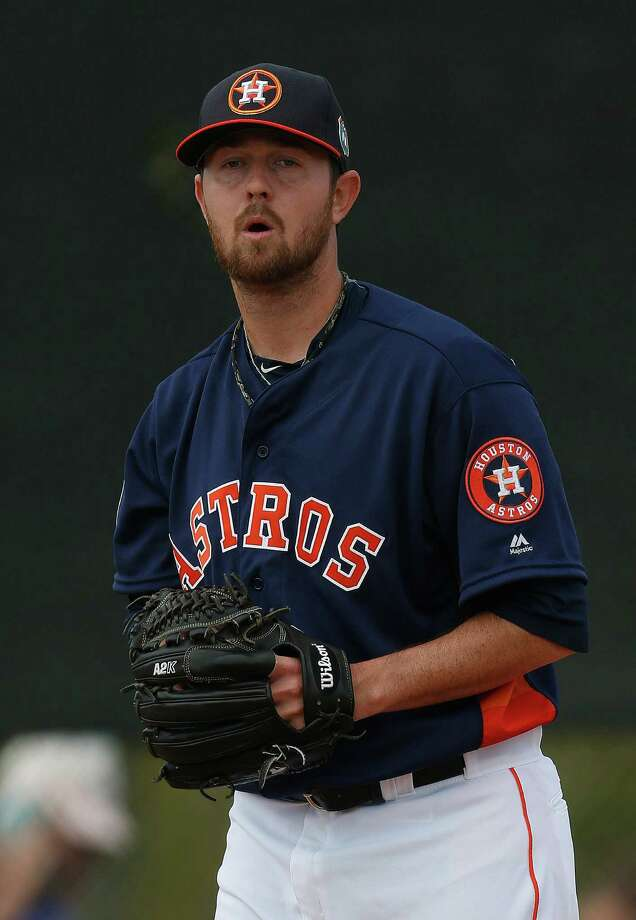 Houston Astros pitcher Brady Rodgers (61) during the first workout for Houston Astros pitchers and catchers for spring training in Kissimmee, Florida, Friday, Feb. 19, 2016. Photo: Karen Warren, Houston Chronicle / © 2015  Houston Chronicle