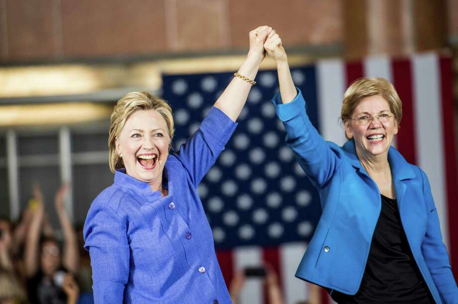 Hillary Clinton and Sen. Elizabeth Warren, D-Mass., greet Ohio voters during a rally at the Cincinnati Museum Center at Union Terminal on Monday. / The Washington Post