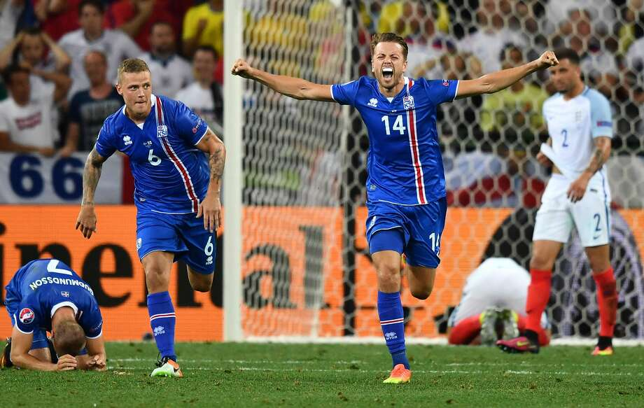 Iceland defenders Ragnar Sigurdsson and Kari Arnason celebrate their win over England. But France will be a more formidable foe. Photo: BERTRAND LANGLOIS, AFP/Getty Images