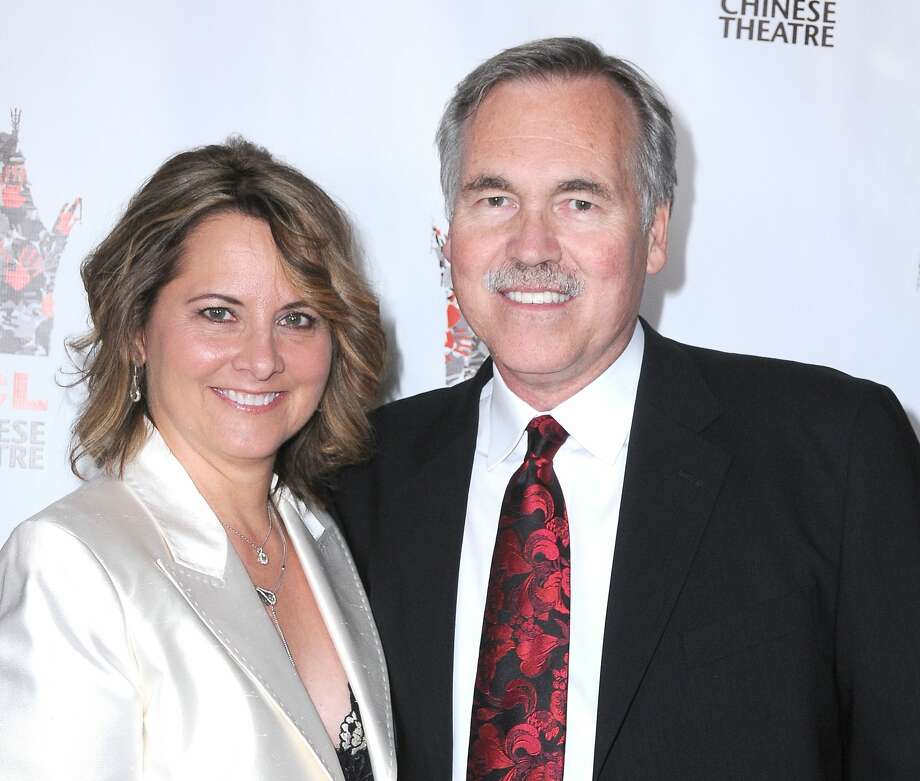 HOLLYWOOD, CA - SEPTEMBER 19:  Rockets coach Mike D'Antoni (R) and wife Laurel D'Antoni arrive at 'Linsanity' - Los Angeles Premiere on September 19, 2013 at TCL Chinese Theatre in Hollywood, California.  (Photo by Barry King/FilmMagic) Photo: Barry King/FilmMagic
