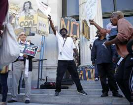 Hoping for more high paying jobs, Oakland resident Gregory Nash counter protests against those trying to bar coal from being shipped through Oakland before City Council meeting on Monday, June 27, 2016.