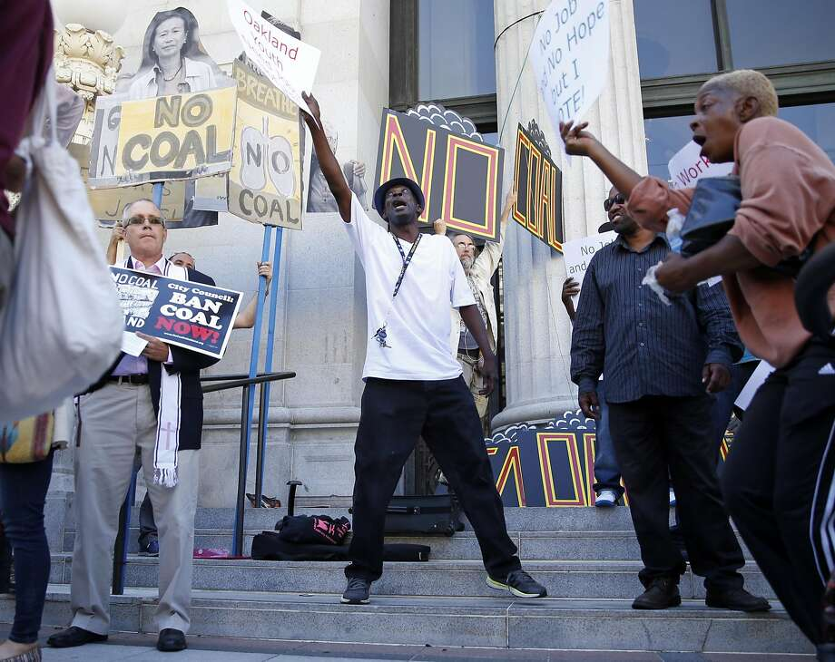 Hoping for more high paying jobs, Oakland resident Gregory Nash counter protests against those trying to bar coal from being shipped through Oakland before City Council meeting on Monday, June 27, 2016. Photo: Scott Strazzante, The Chronicle
