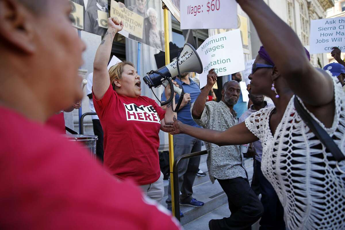 As those hoping for higher paying jobs counter protest, United Local 2850's Jessica Medina (left) leads a protest against coal operations coming to Oakland before Oakland City Council meeting in Oakland, Calif., on Monday, June 27, 2016.