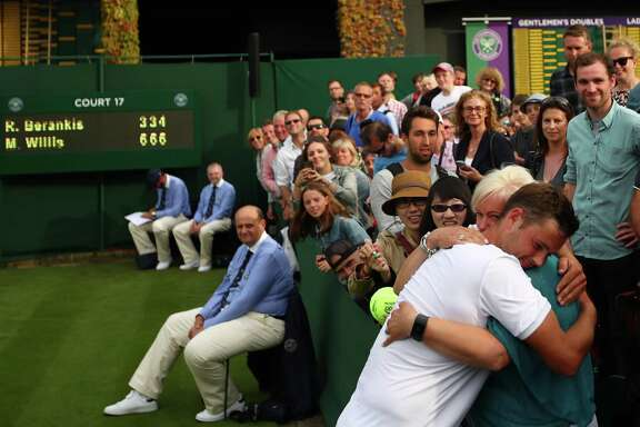 Marcus Willis of Great Britain, left, ranked 772nd, had to win six matches just to get into the main draw at the All England Club. Monday, Willis skipped teaching his tennis class and won his first-round match on tiny Court 17. Then he celebrated with a supportive crowd.