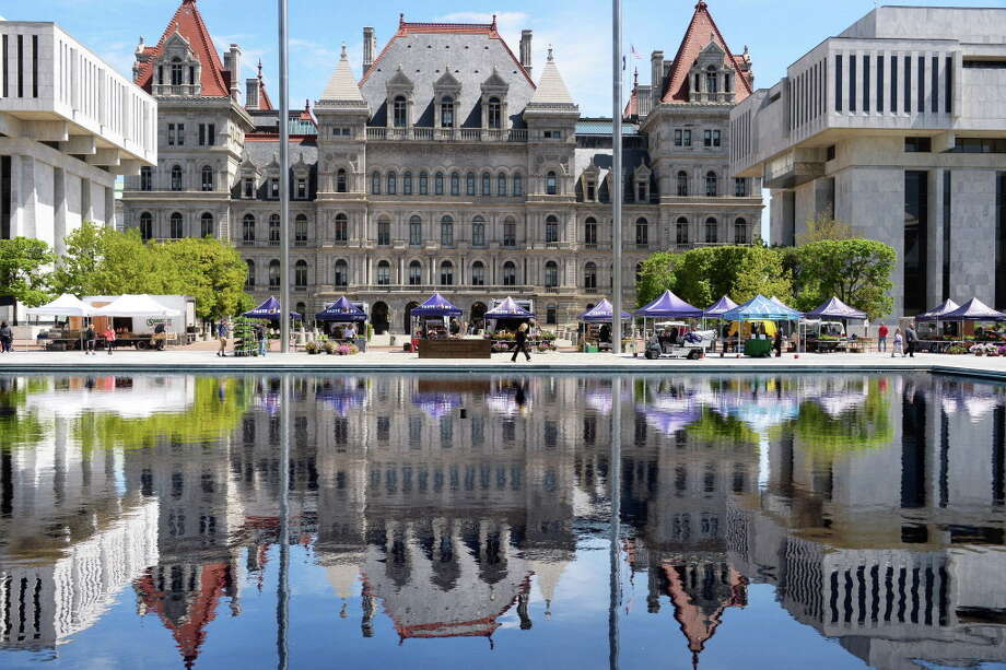 The Capitol and the Empire State Plaza farmer's market can be seen in one of the reflecting pools Wednesday May 18, 2016 in Albany, NY.  (John Carl D'Annibale / Times Union) Photo: John Carl D'Annibale / 40036656A