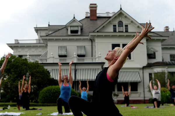 Tiffany Maloney leads a yoga class on the lawn outside the McFaddin-Ward House on Monday evening. The monthly classes take place on the last Monday of every month from May to October.  Photo taken Monday 6/27/16 Ryan Pelham/The Enterprise