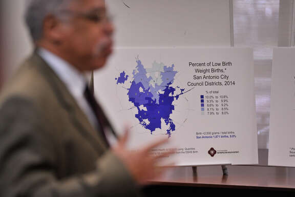 Dr. Vincent Nathan, interim director of Metro Health, speaks in front of a statistics poster during a news conference Monday announcing the Bexar County-San Antonio Fetal Infant Mortality Review committee.