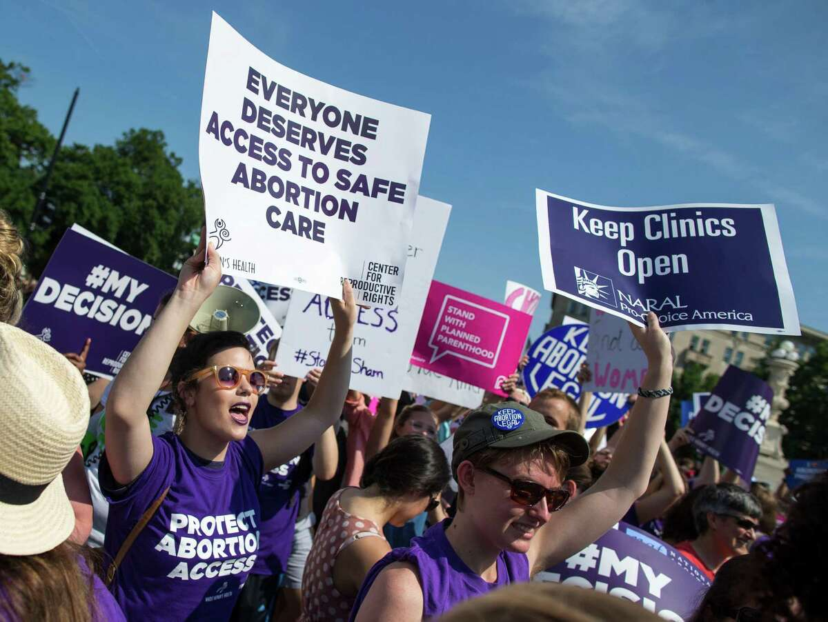 Pro-abortion rights demonstrators react to news of the U.S. Supreme Court's decision on abortion, outside the court in Washington, June 27, 2016. The court on Monday struck down parts of a restrictive Texas law that could have reduced the number of abortion clinics in the state to about 10 from what was once a high of roughly 40. (Al Drago/The New York Times) ORG XMIT: XNYT21