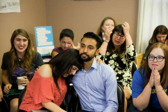 Candice Russell leans on Bharik Kumar after hearing the Supreme Court of the United States' 5-3 ruling on the Whole Woman's Health v. Hellerstedt case at Choiceworks, which is located in a former Whole Woman's Health clinic, in Austin, Texas on June 27, 2016.