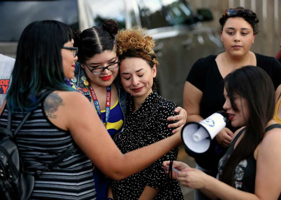Victoria Valdez, second form left, hugs Juanita Renee Rivas, third from left, of the Texas Freedom Network, during a news conference and rally Monday, June 27, 2016 at the Whole Woman's Health of McAllen clinic in McAllen. Valdez and Rivas had gathered with other members of the community to celebrate the Supreme Court's 5-3 ruling that struck down a pair of strict Texas abortion regulations, sparing nearly a dozen clinics in the state from imminent closure. Photo: William Luther, Staff / San Antonio Express-News / © 2016 San Antonio Express-News