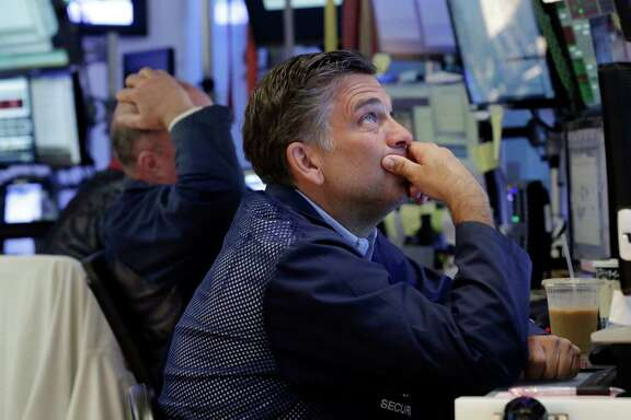 Trader Jeffrey Lucchesi works on the floor of the New York Stock Exchange, Monday, June 27, 2016. Stocks are opening lower on Wall Street following bigger losses in Europe as investors continue to grapple with the fallout of Britain's vote to leave the European Union. (AP Photo/Richard Drew)