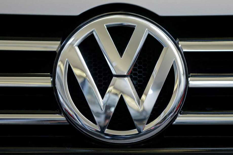 FILE - In this Feb. 14, 2013, file photo, the Volkswagen logo is seen on the grill of a Volkswagen on display in Pittsburgh. Volkswagen would repair or buy back polluting vehicles and pay each owner as much as $10,000 under a $14.7 billion deal the car maker has reached to settle lawsuits stemming from its emissions cheating scandal, a person briefed on the settlement talks said Monday, June 27, 2016. (AP Photo/Gene J. Puskar, File) Photo: Gene J. Puskar, STF / Copyright 2016 The Associated Press. All rights reserved. This material may not be published, broadcast, rewritten or redistribu