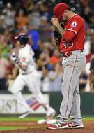 HOUSTON, TX - JUNE 21: Hector Santiago #53 of the Los Angeles Angels of Anaheim looks down as Carlos Correa of the Houston Astros (L) rounds the bases after hitting a solo home run during the fifth inning at Minute Maid Park on June 21, 2016 in Houston, Texas. (Photo by Eric Christian Smith/Getty Images)