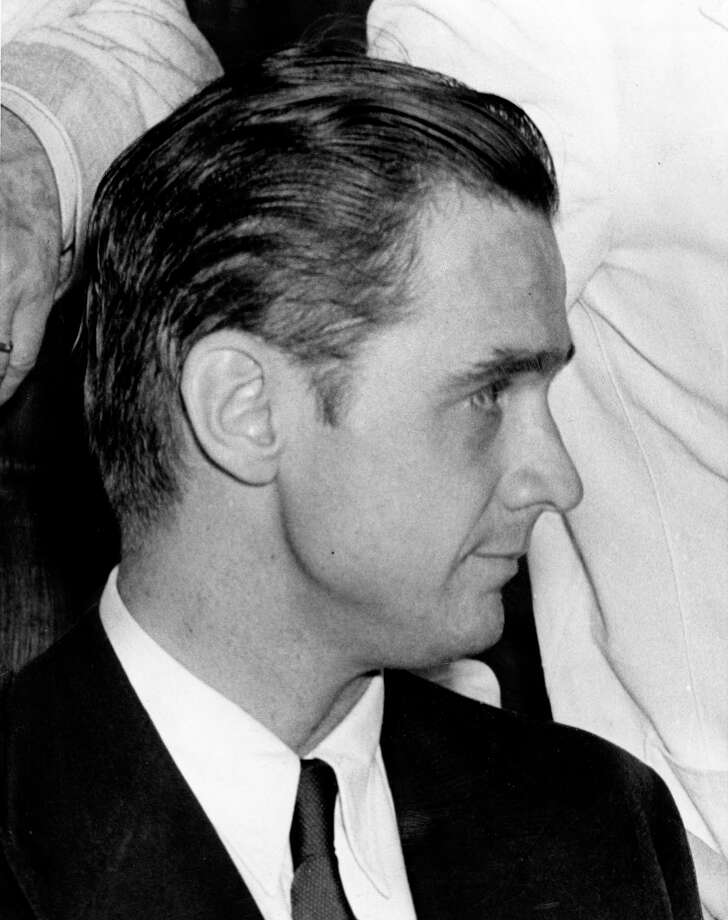 Howard Hughes, 32, is feted in New York with an official welcome and congratulations following his record-setting around the world monoplane flight in less than 4 days. / AP Wirephoto